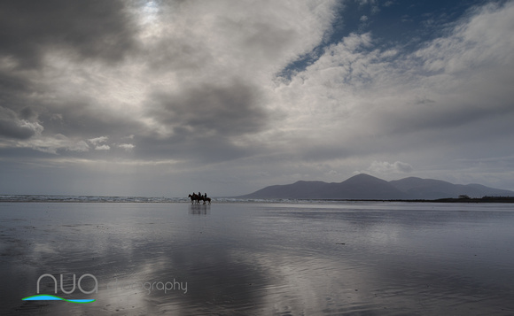 Tyrella Beach reflections and horse riders