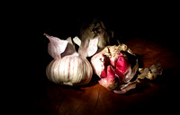 Rich still life photography of Irish Red onions and garlic